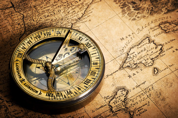 Wall Mural - old compass on vintage map