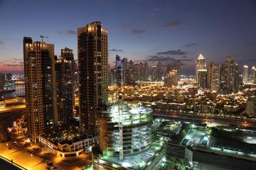 Dubai Downtown illuminated at dusk. United Arab Emirates