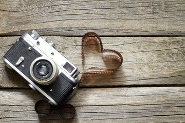 Old retro camera with heart love photography creative concept