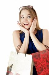 Portrait of shopping happy girls against white background.