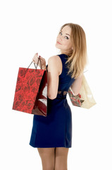 Shopping happy girl whis shopping gift bags, against white backg