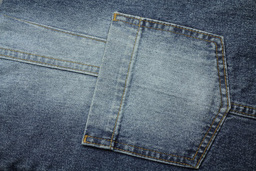 pocket dyed blue jeans fabric background
