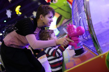 Mother with son playing in amusement