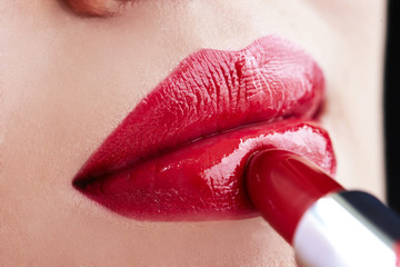 Close-up of a lipstick on a woman's lips