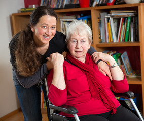 female senior in wheelchair with her daughter