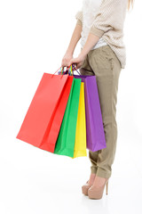 shopping girl, young woman on high heels with colored shopping b