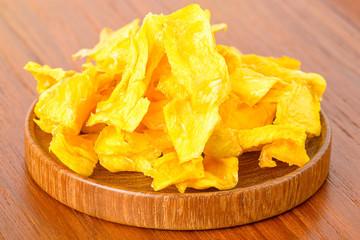 Dehydrated mango on wooden platter