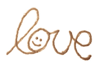 Love with smiley written with sand