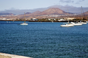 pier rusty chain  water   summer lanzarote spain