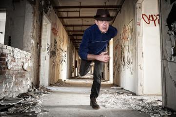 Man runs away in abandoned building
