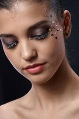 Closeup portrait of glittering makeup
