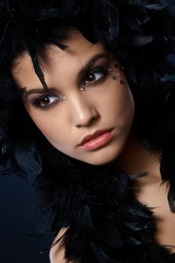 Attractive woman with black feather boa