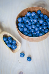 Fresh blueberries on wooden background