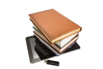 Ipad  with books and flash on a white background