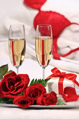Champagne glasses and roses to celebrate Valentine's Day