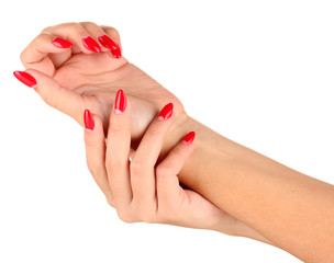 Beautiful female hands with red nails isolated on white