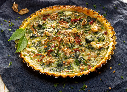 Spinach quiche with the addition of sun dried tomatoes and nuts