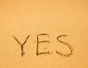 YES - written in sand on sea beach texture.