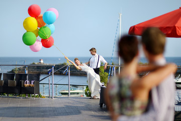 Bride and groom with colorful balloons