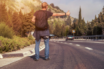 Hitchhiking traveler on the road