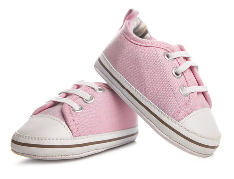 pink baby sneakers on white background