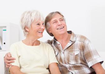 Happy Senior Couple Looking Away