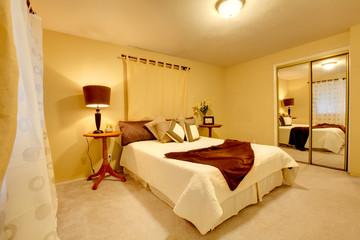 Elegant bright bedroom with walk-in closet
