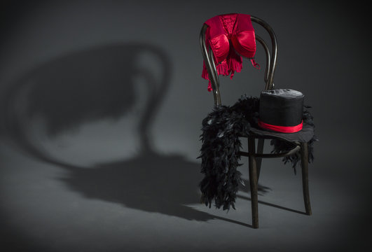 On retro chair is a cabaret dancer clothing.