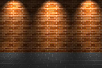 Fragment of light on orange brick wall and floor
