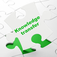 Education concept: Knowledge Transfer on puzzle background