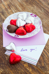Card with Message Love You and chocolate candy