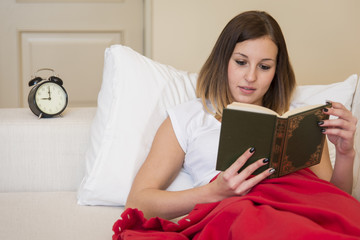 woman bed reading book