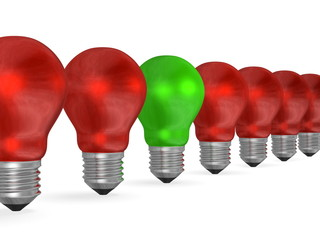 One green light bulb in row of many red ones