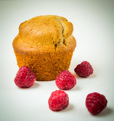 Wall Mural - Raspberry muffin isolated on white background