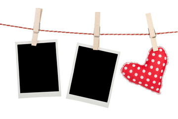 Blank instant photos and red heart hanging