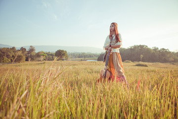 Hippie woman in golden field