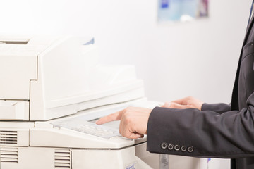 man using a copy machine (shallow DOF)