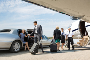 Business Partners About To Board Private Jet