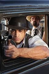 Muscular Gangster Shooting Gun