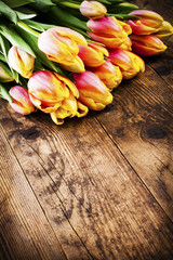 Tulips in old wood background.