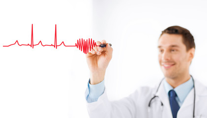 male doctor drawing heart in the air