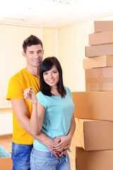 Young couple moves into new home