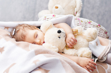 sleeping girl with a toy
