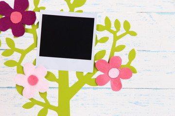 Holder in form of tree with instant photo card