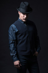 Retro 1900 modern fashion man. Wearing blue jeans shirt with gil