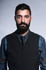 Retro hipster 1900 fashion man in suit with black hair and beard