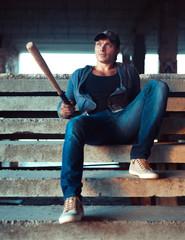 Man with baseball bat on the ruins