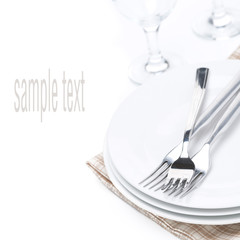 tableware for dinner, plates, forks and glasses, selective focus