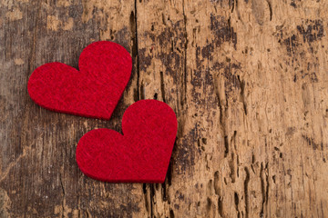 red hearts on wooden surface for valentine