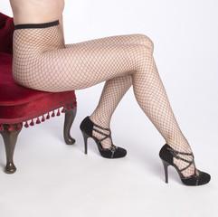 Woman wearing black fishnet tights